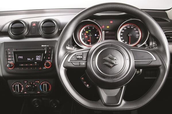 Interior of the Suzuki Swift showing steering console and radio