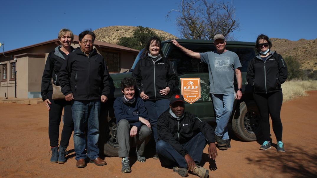 Suzuki team with researchers at Jimny.